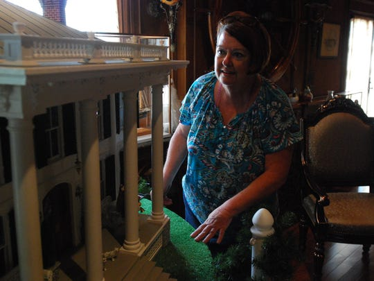 Sandra Brown looks at a dollhouse of the Capt. David Lester House crafted by her father, William.