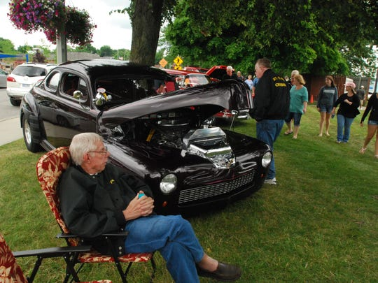 Phil Dersam, of St. Clair, shows off his 1947 Ford