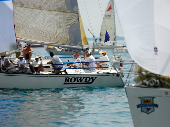 Rowdy, of the Port Huron Yacht Club, takes off at the start of the Class G race July 18, 2015, during the sailing of the Port Huron-to-Mackinac race.