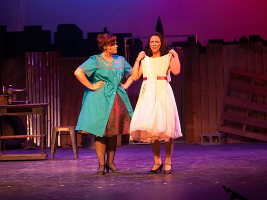 """Jessica Adamson as Anita and Kate Welsh as Maria in CenterStage's production of """"West Side Story."""""""