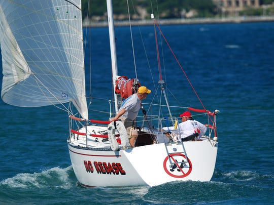 The No Rebase, a sailboat owned by Linda and Ralph Richards of Troy, heads up the St. Clair River on its way to Port Huron.