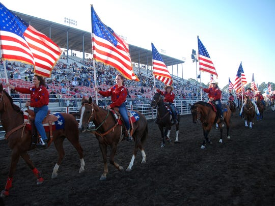 American flags abound at Friday night's Grand Entry to the 102nd California Rodeo Salinas.