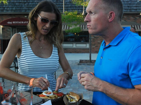 Jennifer and Wes Peyerk enjoy some of the food offerings Friday at the St. Clair Beer and Wine Festival.