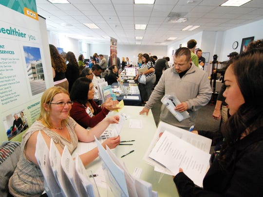 Enid Donato, left, and Stacy Scherer of Natividad Medical Center talk to job seekers at Thursday's 1st Annual Salinas Community Job Fair.