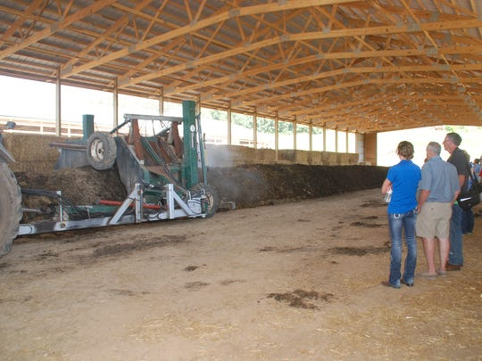 Visitors to a Yahara Pride Farms field day saw the turning of compost from dairy heifer manure at a Waunakee area farm. A new building was created to house the compost so it can be worked all year, regardless of weather.