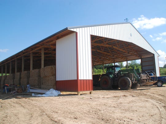Endres Berryridge Farms has built a new structure for use in creating compost from dairy heifer manure. It is a twin to the adjacent heifer barn; if for some reason the compost project doesn't work out, they can use it as another heifer barn.