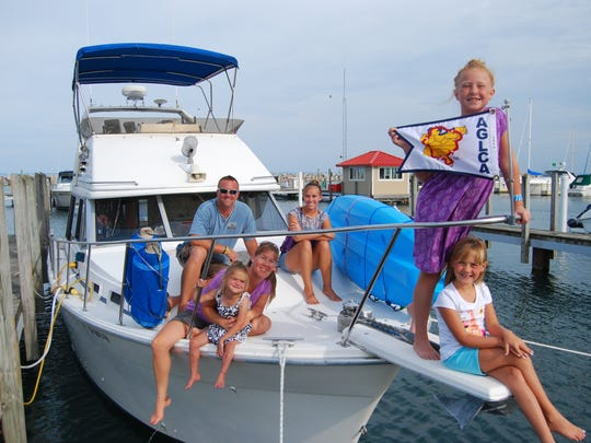 Members of the Wilson family are traveling around the eastern United States by boat. From left are, Bobby, Wendy, Mia, Nina, AnnaMay and Ella.