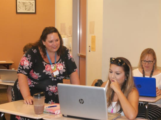 Teacher and paraeducators work with fellow educators to brush up on skills and learn new ones in the Summer Institute.