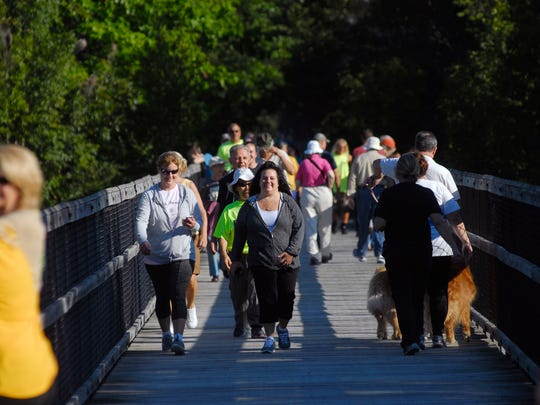 Participants cross the bridge Monday, Sept. 5, 2016, during the annual Trestle Trek along the Wadhams-to-Avoca Trail.