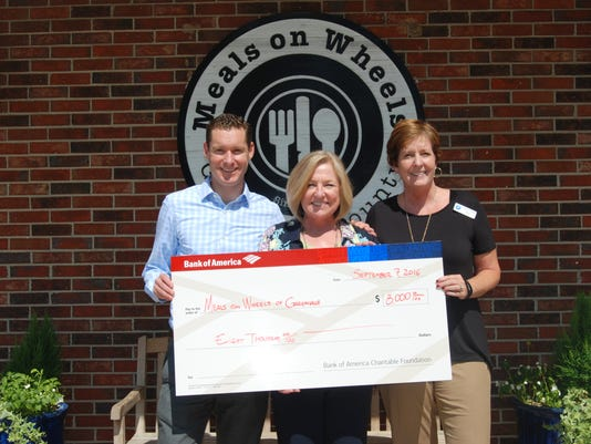 Luke-Barnett-left-with-Bank-of-America-presents-a-check-to-Meals-on-Wh....jpg