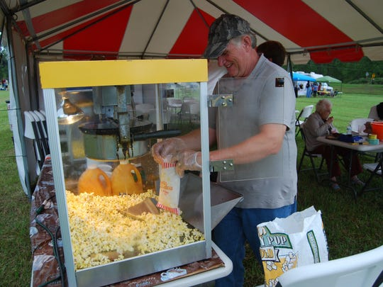 Volunteer Ed Laura bags popcorn at the Kimball Township Fall Family Fun Night.