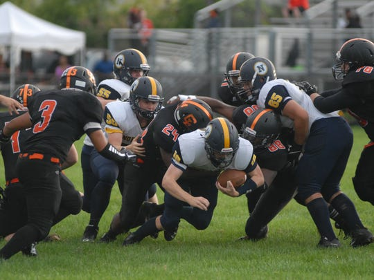 Billy Fealko (10) is tackled on his way toward a first down in Port Huron Northern's 28-6 win at Center Line on Sept. 10, 2016.