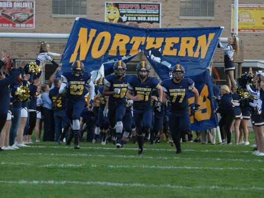 Port Huron Northern takes the field in front of a homecoming crowd against East Detroit on Sept. 23, 2016.