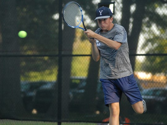 Yale's Matt Donnellon returns a serve at the Division 3 regional meet on Oct. 8, 2016.