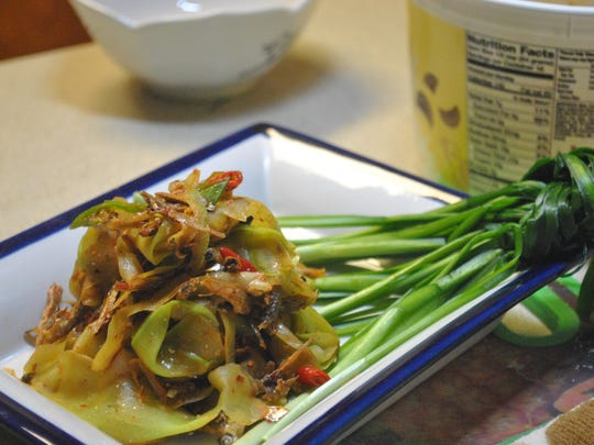 The last of the three vegetable creations is a ribbon pile of long squash, also called kalabasa in Chamorro, or upo in the Philippines. Here, it gets a decidedly Korean touch with a bit of gochujang, crispy fried anchovies and a generous helping of fresh hop peppers. It is served atop a knot of chives.