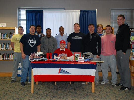 Siegel's Chace Witherow, seated, recently signed a