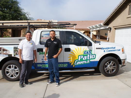 Sergio Ramirez, left, and Chris Angulo outside their home office in Mecca. The patio cover outside the front of the house was one of C&S Patio Covers' first projects.