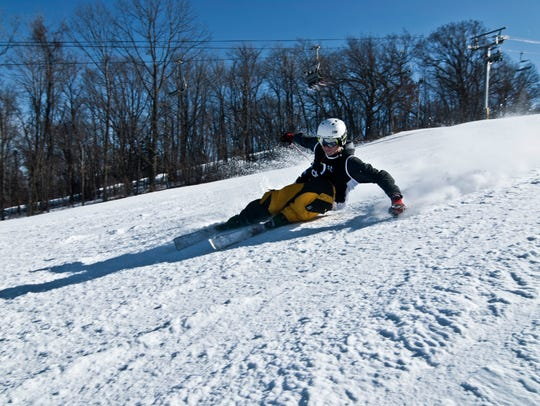 A skier carves a turn at Cascade Mountain in Portage.