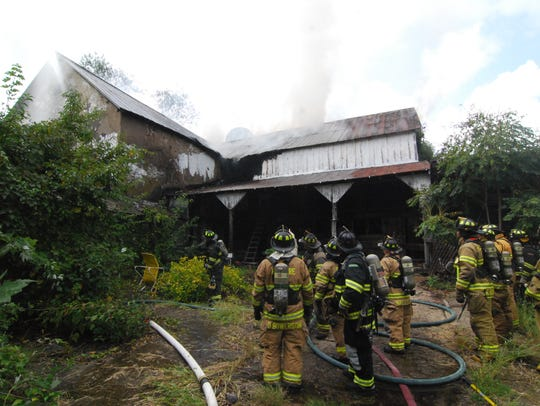 A fire ravaged a historic barn on the historic Coffee