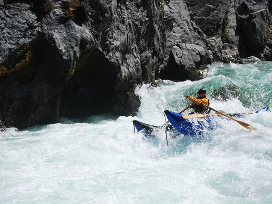 Mike Dearing takes on the Illinois River's rapids.
