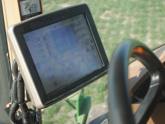 This monitor mounted in a tractor helps the operator
