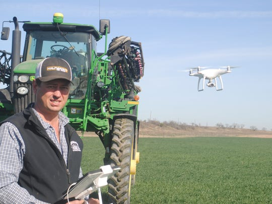 Chad Halfmann uses the drone to fly the field and gather