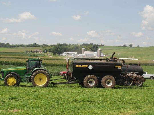 Low-disturbance manure injection, using equipment like