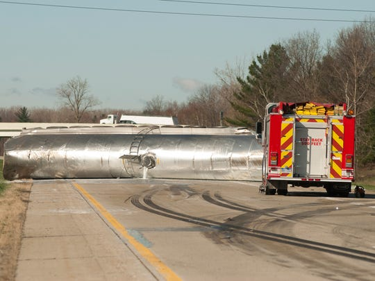 A rolled milk tanker shut down westbound Interstate