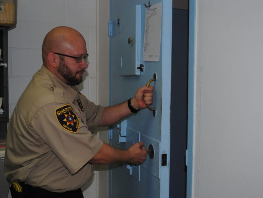 Wichita County Sheriff's Office Detention Officer Josh Wood locks a cell door Thursday at the Wichita County Downtown Jail Annex. The WCSO is having a job fair to hire 19 detention officers for the county jail on April 7 from 10 a.m. to 2 p.m. at the courthouse.