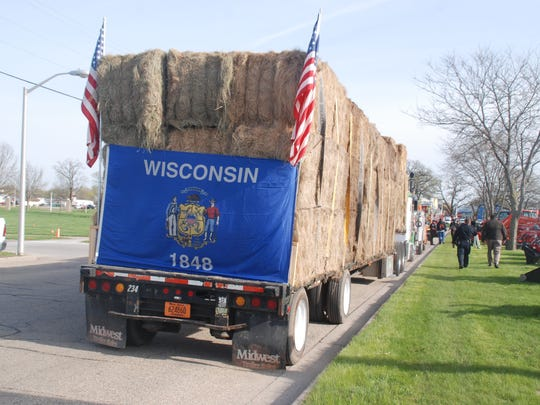 There's was no mistaking where this donated load of hay came from on Monday morning in Sauk City. It was headed for farmers and ranchers in a burned out county in Kansas after a group of local farmers raised money, donated hay and solicited donations.