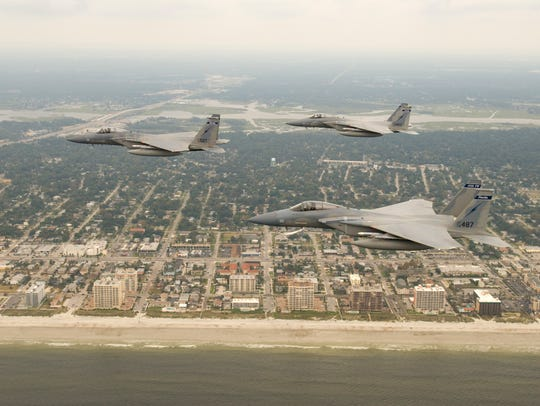 F-15 Eagles from the 125th Fighter Wing fly over the
