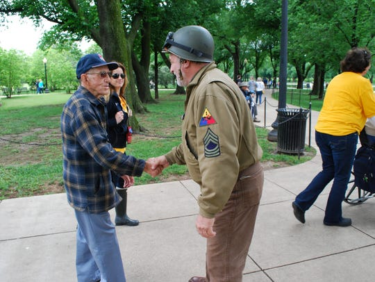 Army veteran Ralph Hughes, of Fairview, is greeted