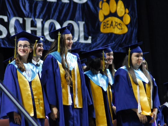 Honor students stand for recognition at the Carencro High School graduation, May 20, 2017.
