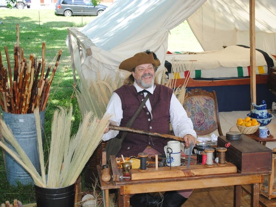A broomaker at a past Spirit of Vincennes Rendezvous not only sells his brooms but also demonstrates the process.