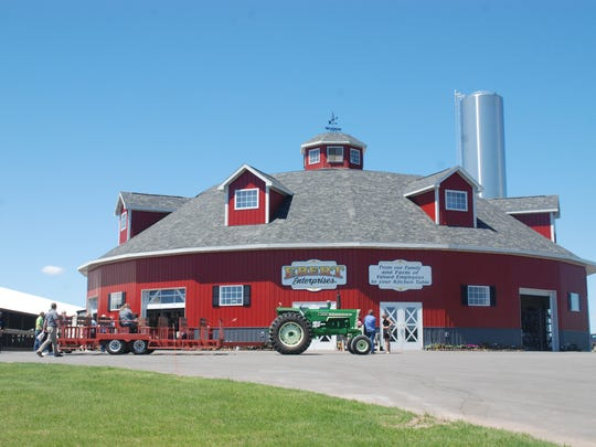 A new rotary parlor at Ebert Enterprises, home of this year's Farm Technology Days in Kewaunee County, was built inside a round barn – a nod to the host family's ancestors who were barn builders.