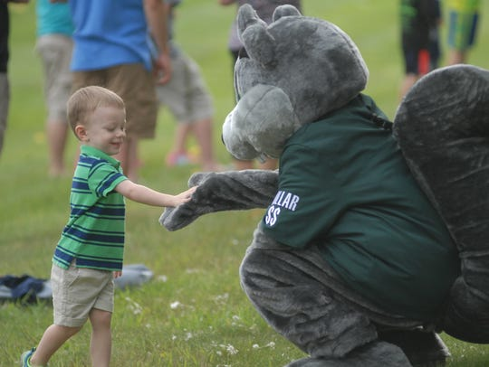 Dollar the Squirrel, the Chemical Bank mascot, interacts