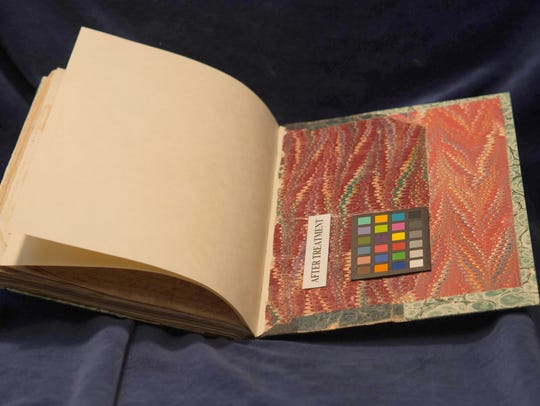 The volume's open back cover is restored through preservation