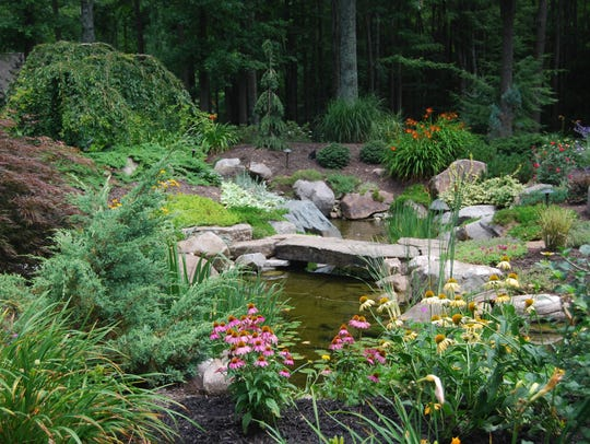 A landscaped pond area included in a Williamsburg Garden