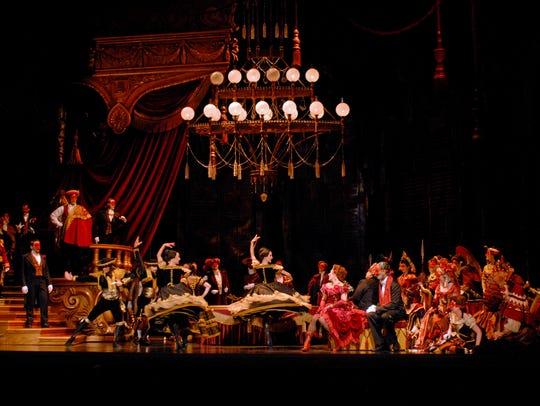 An opulent party scene with dancers in Cincinnati Opera's