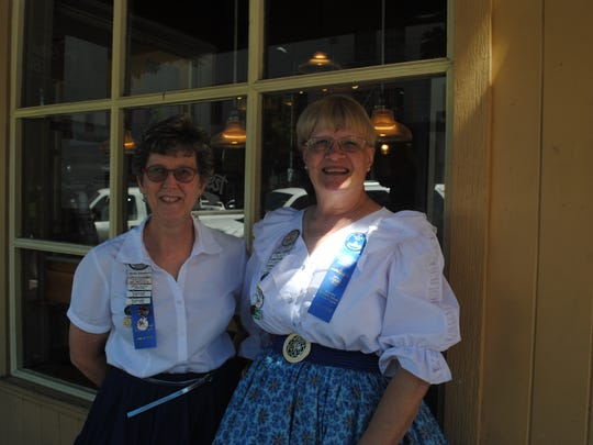 Becky Daugherty, left, and Ronda Whaley of the Independence Wagon Wheelers Square Dance Club came out to promote a summer festival.