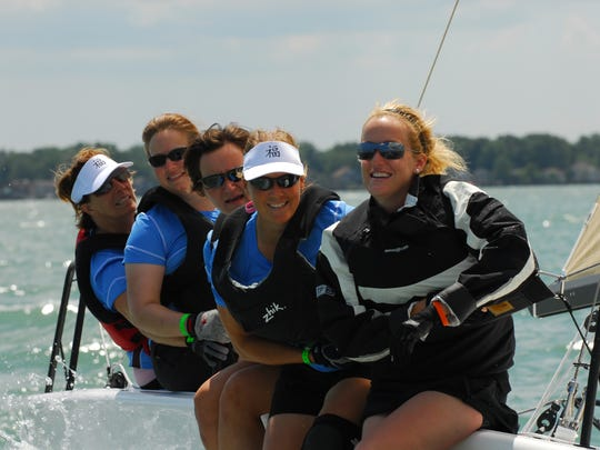 Lynn Kotwicki (second from right) races in a Women on Water event through the Bayview Yacht Club.