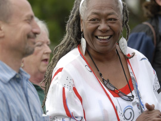 Ruth Wise, executive director of the New Road Community Development Group of Exmore Inc. laughs before the start of the group's 17th year celebration at the community's park.