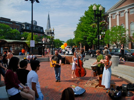 Busking refers to the practice of performing in public places for gratuities or tips. These musicians performed in Cambridge's Harvard Square in Massachusetts in 2008.