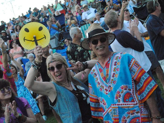 Smiley faces and psychedelic clothing dotted the landscape at the Magic Bus concert.