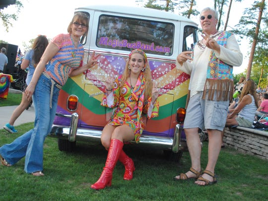 This modern-day Mod Squad -- Linda Crawford, Samantha Shoulders and Charlie Crawford -- pose with the Magic Bus.