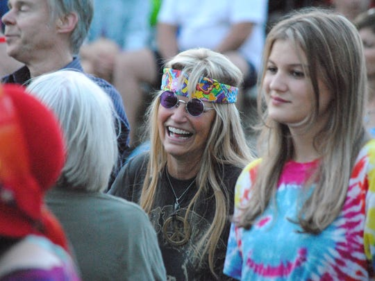 A large and enthusiastic crowd donned headbands and tye-dyed T-shirts.