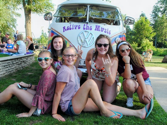 Milford High School students Maria,Taylor,Nicole,Riley and Kristen gather around the Magic Bus.