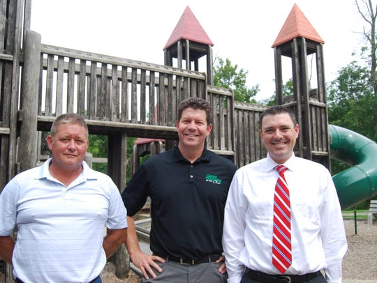 Eric Schmidt, left, with Playground Equipment Services