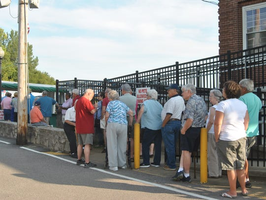 The crowd lines up Friday evening at the Old Lock &