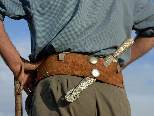 Gaucho, Argentinian cowboy, with silver knife and leather belt